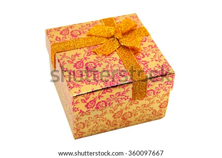 The orange - metallic gift box with ribbon bow. Holiday present. Object isolated on white background. - stock photo