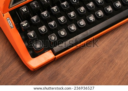 The Orange Vintage Typewriter on the Wood - stock photo