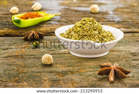 The oregano on wood texture for decorate or design project. - stock photo
