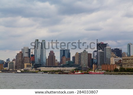 The outside of buildings in Manhattan in New York City. - stock photo