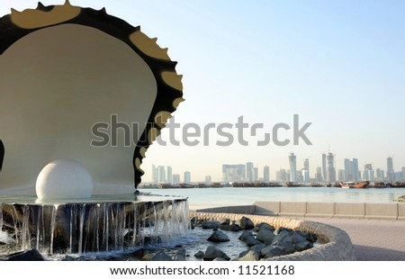 The oyster and pearl fountain in Doha, Qatar, with the skyline of the new high-rise district seen  in the background. April 2008 - stock photo