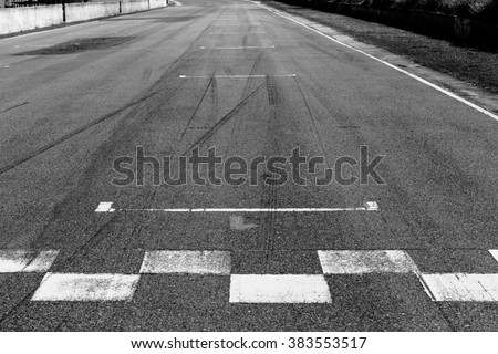 The painted start/finish line across the track  - stock photo