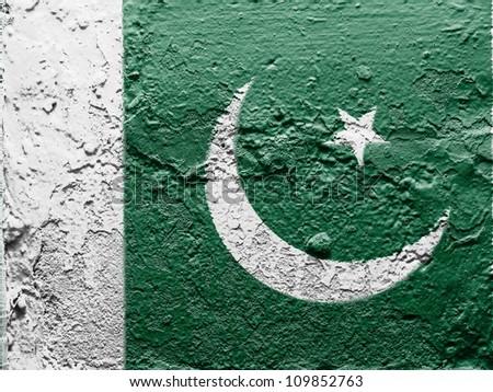 The Pakistani flag painted on grunge wall - stock photo