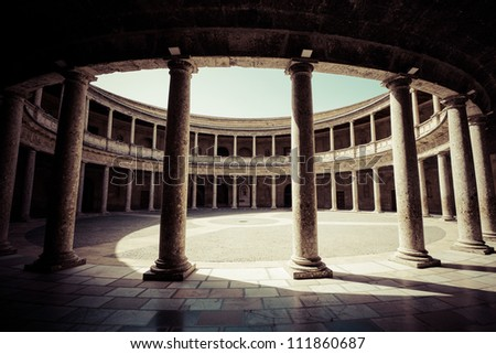 The Palace of Charles V is a Renacentist construction in Granada, southern Spain, located on the top of the hill of the Assabica, inside the Nasrid fortification of the Alhambra. - stock photo