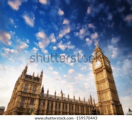 The Palace of Westminster is the meeting place of the House of Commons and the House of Lords, London. - stock photo