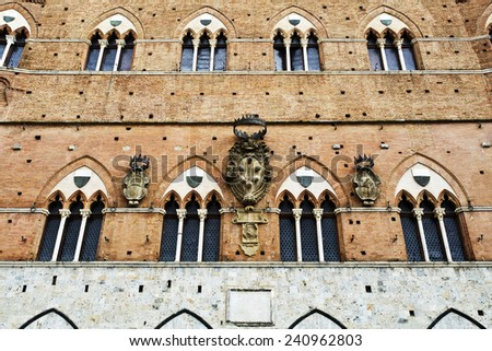The Palazzo Pubblico and the Torre del Mangia in Siena, Italy, isolated in white. - stock photo