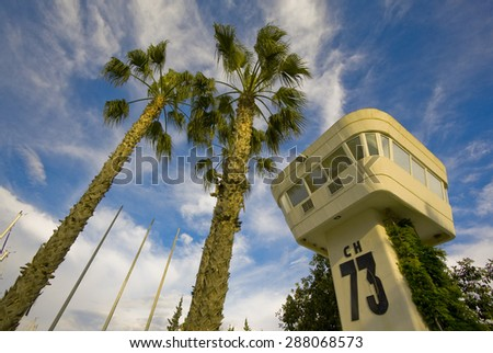 The palms and the lockout tower on the background of blue sky. - stock photo