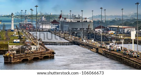 The Panama Canal, which connects the Atlantic Ocean to the Pacific Ocean, is a key conduit for international maritime trade in Panama. - stock photo