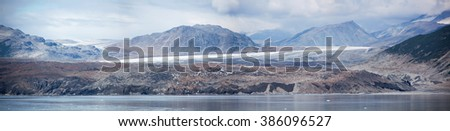 The panoramic view of a black color glacier, one of the biggest in Glacier Bay national park (Alaska). - stock photo