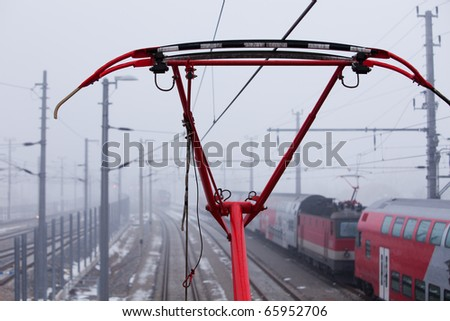 the pantograph of the train is red - stock photo