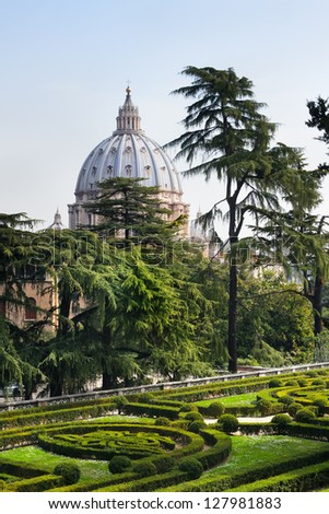 The Papal Basilica of Saint Peter from gardens of Vatican - stock photo