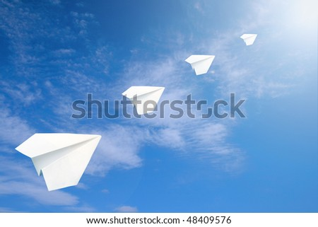 The paper airplanes to the air. - stock photo