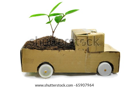 The paper automobile and the seedling , - stock photo