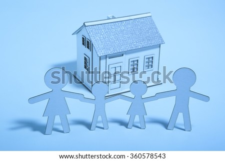 The paper family buys a home. Blue light - stock photo