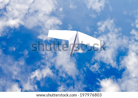 the paper plane in the sky - stock photo