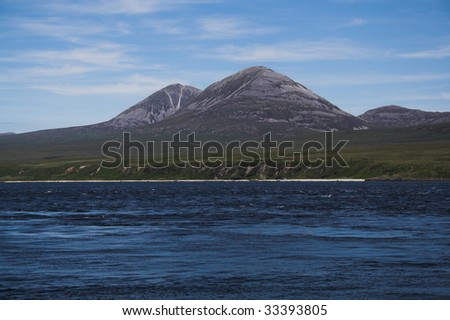 The Paps of Jura seen from Port Askaig, Islay - stock photo