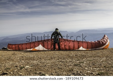 The paraglider preparing the equipment for the launching / Ready to fly - stock photo