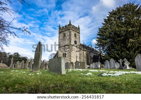 The parish church and graveyard at Ashford-in-the-Water, Derbyshire. - stock photo