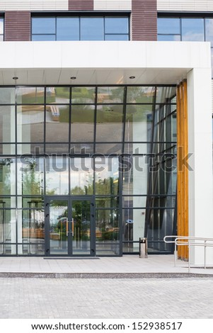 The part of facade of modern business center with glass doors - stock photo