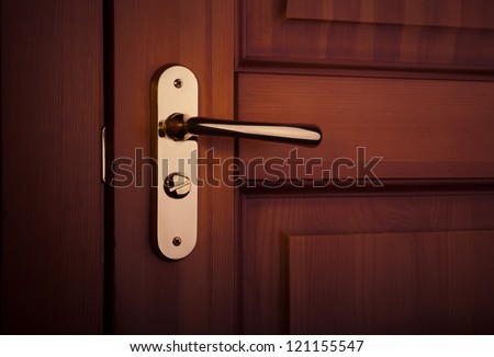 the part of wooden door with metal handle - stock photo