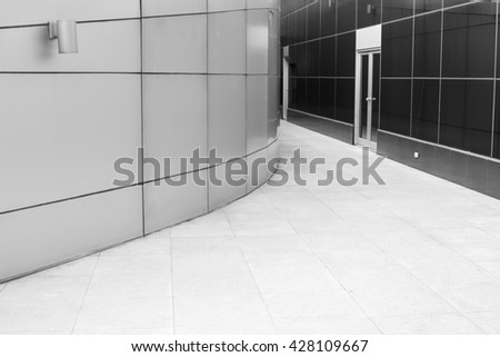 The passage of modern building selective focus at door. black and white image. - stock photo