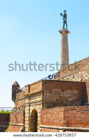 The passage through the walls of the Kalemegdan fortress and a monument Victor. - stock photo