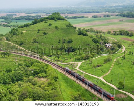 The passenger train moves along the trans-siberian railway (Primorsky region, Russia) - stock photo