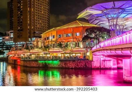 The past and the future. Night view to Clarke Quay. Singapore - stock photo