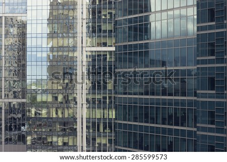 The pattern of an office building with reflection. - stock photo