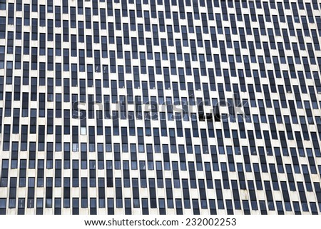 The pattern of windows of the new yorker building. - stock photo