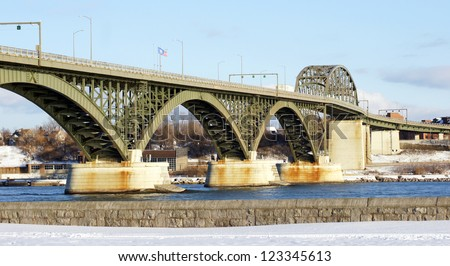 The Peace Bridge, which is one of the main border crossings between Canada and the United States, runs between Buffalo, New York and Fort Erie, Ontario - stock photo