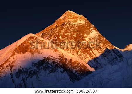 The peak of the highest mountain in the world - Mt. Everest at the sunset. - stock photo
