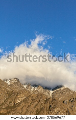The peaks of the Remarkables mountain range above lake Wakatipu, Queenstown New Zealand. - stock photo