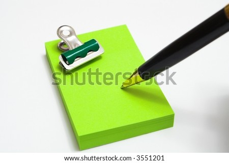 The pen writes on a small leaf - stock photo