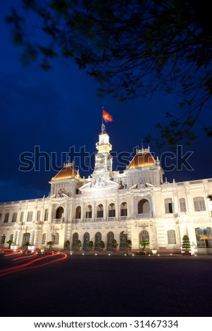 The People's Committee building, also named Hotel de Ville, located in Saigon, Ho Chi Minh city, in dusk. - stock photo
