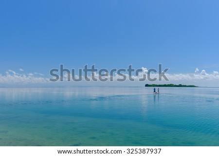The perfect aquamarine shallow waters of the florida keys are a perfect vacation spot for their calm clear and shallow waters - stock photo