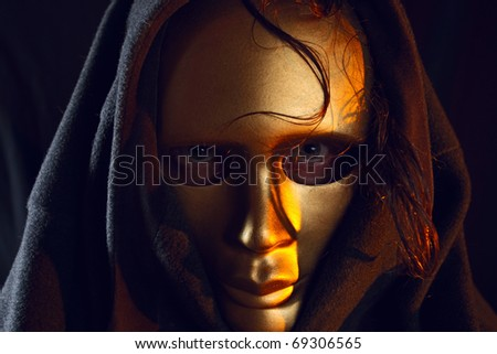 The person in a gold mask. - stock photo