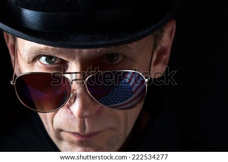 The person in the dark glasses, attentively looking at you - stock photo