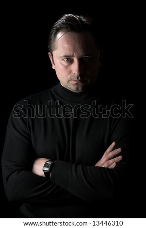 The person thinks. ïîòðåò on a black background - stock photo