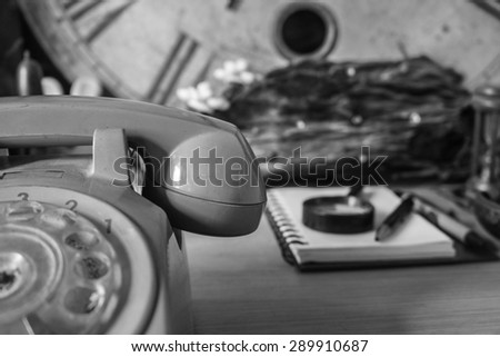 The phone on the desk with a black and white image. - stock photo