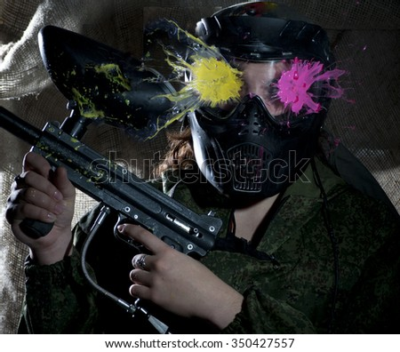 the photo as a paintball sphere is broken off at blow about a helmet - stock photo
