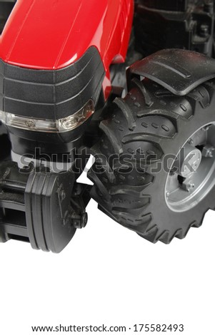 The photo of a red tractor on a white background - stock photo