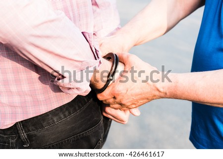The photo shows the arrest of a man. - stock photo