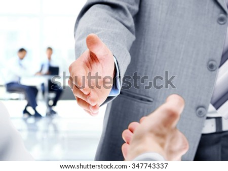 The photo shows two businessman shaking hands - stock photo