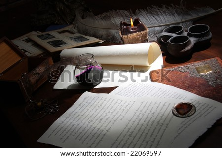 The photograph of the inkstand and the notebook of the paper - stock photo