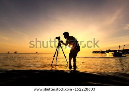 The Photographer takes a good shot on the Huahin beach, Thailand - stock photo