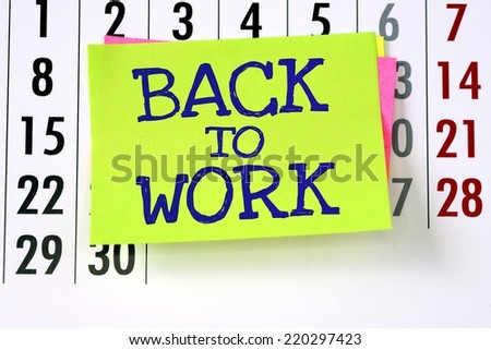 The phrase Back To Work on sticky paper note stuck to a wall calendar background - stock photo