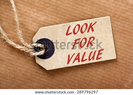 The phrase Look For Value in red text on a price or luggage tag with string on brown wrapping paper - stock photo