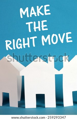 The phrase Make The Right Move above a paper chain of houses cut out of white card on a blue background - stock photo