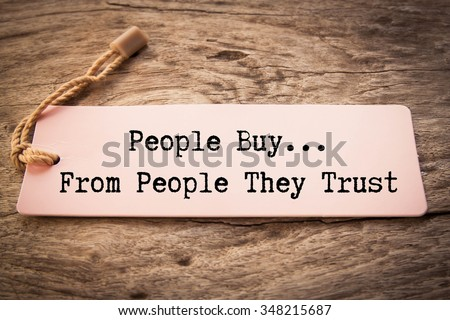 The phrase People Buy From People They Trust  - stock photo